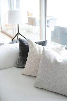 Styling sofas with different pillow colors and textures makes for an inviting aura on a white leather sofa.