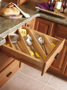 Utilize your kitchen drawer space and keep utensils organized with organization solutions from Diamond. http://www.diamondcabinets.com/