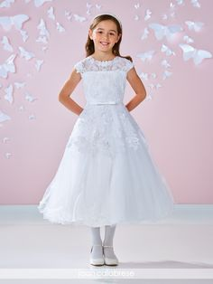 117340 - Satin, tulle and lace tea-length full A-line dress with front and back lace illusion necklines and cap sleeves, allover Chantilly lace bodice with re-embroidered lace appliqués and three-dimensional flowers, satin covered buttons down lace illusion back, set-in satin waistband with front bow, lace adornment continues down skirt finished with wire edged hemline.