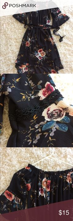 Gorgeous black and floral dress I love this dress! Ordered online and sadly it didn't fit me in the shoulders. Has cute little detail on the sleeves, high low. Never worn! Dresses High Low