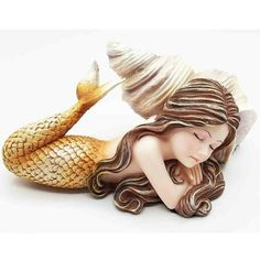 Young Mermaid by Snail Sconce Shell. www.teeliesfairygarden.com . . . See how stunningly beautiful she is? The fairies would be mesmerized! Bring her home today! #fairymermaid