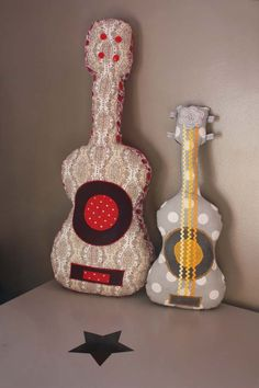 Guitar pillows. My boys would love them! And i think my husband would too :-)
