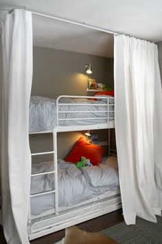 Astonishing Bunk Beds Ideas Bedroom With White Metal Bunk Bed Frame And Ladder Also White Black Stripped Pattern Comfortable Bedding Sheet Along White Curtains As Mosquito Net As Well As Beds And Beds Also Bunk Bed Mattress, Exquisite Design Ideas Bunk Beds For Kids: Kids Room