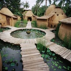 cob-built village, built like spokes on a bicycle around a central fountain hub.