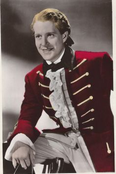 """Color Postcard of Nelson Eddy from Naughty Marietta. Back of the PC states: """"Colourgraph Series No. C254. This is a Handcoloured Real Photograph"""" - ESCANO COLLECTION"""