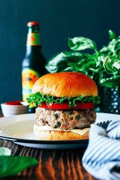 Perfect for a 4th of July party, this simple turkey burger recipe packed with fresh basil. Inspired by Burger Lounge!