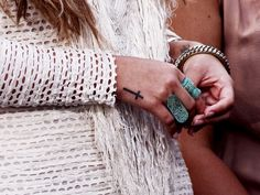 love Demi L's cross tat, i'd just get it in a different spot and in white or brown ink