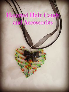 Real Candy Sprinkles in Resin Ribcage Heart topped with a cute Black bow 100% Handmade  LIKE on Facebook https://www.facebook.com/hauntedhaircandy  Follow on Instagram  http://instagram.com/hauntedhaircandy