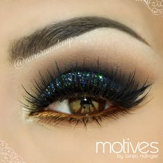 Midnight blue glitter and bronze eyes,eye-makeup, bold & dramatic...Love that bronze waterline.