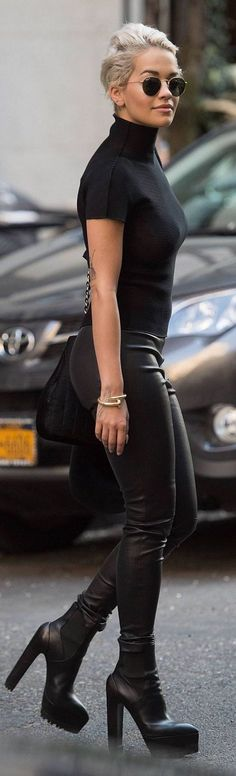 street fashion. all black. leather look skinny.