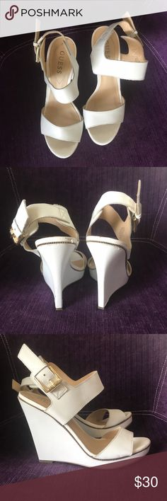 White Guess wedge heals Size 7 White Guess wedge heels. Size 7. Gold zipper detail. Only worn a few times. Minimal wear with plenty of life left! Guess Shoes Wedges