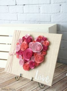 Curl paper flowers and glue them to a burlap canvas. Would be cute for…