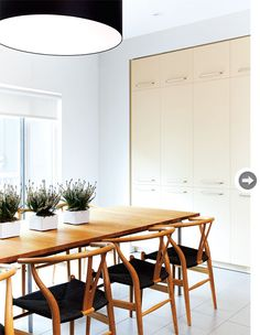 An oversized light fixture anchors this eat-in area.
