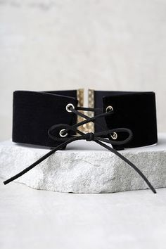 """The Often Black Velvet Lace-Up Choker is the sexy look we've been craving! This trendy velvet choker features a lace-up front and gold grommets. Necklace measures 11.75"""" long with a 4.25"""" extender chain."""