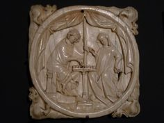 Met Museum: Carved ivory mirror case; couple playing chess.