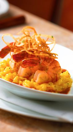 Risotto ai Gamberretti | Experience this famed dish from our onboard Portofino restaurant, which utilizes tiger shrimp sautéed with fresh herbs placed on a bed of creamy saffron risotto.