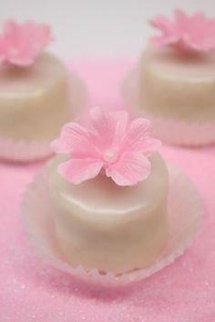 Mini vanilla petit fours with pink gum paste flowers