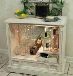 TV cabinet repurposed into a shabby chic liquor cabinet.