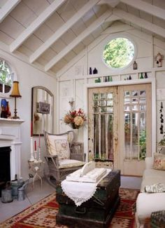 Comfy quarters. This shabby chic shed doubles as a mini guest house, thanks to a sofa that pulls out into a bed. What a cozy place to stay!