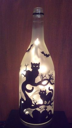 Halloween cats in a dead tree, bats, grave Recycled Wine Bottle Lamp light wine bottle crafts Halloween cats in a dead tree, bats, grave Recycled Wine Bottle Lamp light Diy Bottle Lamp, Glass Bottle Crafts, Wine Bottle Art, Painted Wine Bottles, Lighted Wine Bottles, Vintage Bottles, Vintage Perfume, Decorated Bottles, Lights In Bottles