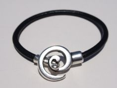 'Swirl Clasp Leather Bracelet' is going up for auction at  5pm Sun, Aug 11 with a starting bid of $5. www.tophatter.com