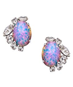 The opal crystal earrings from offer a magnificentsparkle. The large pale blue opal is complimented with a border ofclear swarovski crystals for additional elegant allure. They're madewith clip-on posts for non-pierced ears. $275.00 by Max & Chloe