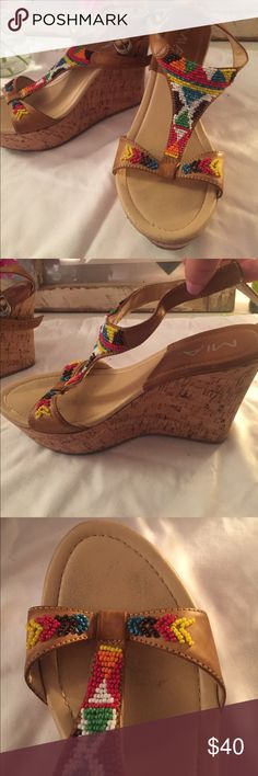 MIA Tribal Print Cork Wedges Super cute multi-colored beaded tribal print cork wedges. Work very few times, very faint toe markings. No other obvious signs of wear, in excellent condition. Mia Shoes