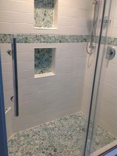 Stunning Shower floor, border, and niches using Sliced Sea Green Pebble Tile. https://www.pebbletileshop.com/products/Sliced-Sea-Green-Pebble-Tile.html#.Vp6HgLiANBc