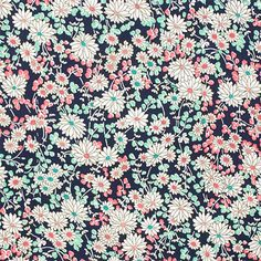 "Pink Mint Daisy on Navy Blue Cotton Jersey Blend Knit Fabric - Love this print!  Sweet white daisy flowers on a navy blue background with colors of mint green, pink, and orange on a cotton jersey rayon blend knit.  Fabric is soft, light to mid weight, with a nice drape and stretch.  Biggest flower measures 1"".  ::  $6.25"