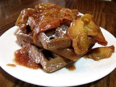 Flavorful Gingerbread Waffles with a hint of spice are the perfect mate for a warm Cinnamon Apple topping.
