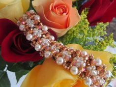 Crystals and Pearls Bracelet.  Materials:  3 colors of 4mm bicones (96, 44, 12 respectively), 48 4mm pearls, 24 6mm pearls, 11/0 seed beads