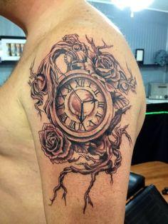 Grey Ink Clock And Rose Tattoos On Shoulder
