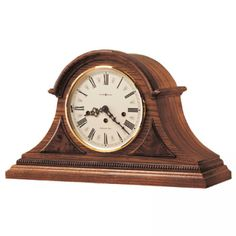 Howard Miller. Stinking expensive for a clock, but it is beautiful and would last generations.
