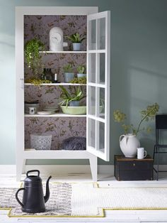 Great cabinet with wallpapered backing