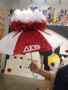 Excited About the umbrella I made for our program on Saturday. The theme is New Orleans and we are having a second line parade, so you know I had to be owt right? Delta Sigma Theta Gifts, Alpha Kappa Alpha, Diy Arts And Crafts, Handmade Crafts, Second Line Parade, Delta Girl, Graduation Cap Decoration, Cap Decorations, Fraternity