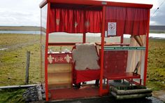 The Jubilee-themed bus stop on the Shetland Island of Unst is fit for a queen. Locals have fitted it out with a phone, ER-themed coushions and paintwork and even some velvet drapes.  Picture: Caters