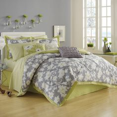 Love the color scheme  dark grey walls, light gray and lime green bedding