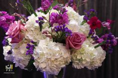 Beautiful floral arrangement with white hydrangeas, pink roses and purple statices.