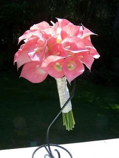 Pink calla Lilly bouquet. If only I could find a husband to agree to a pink wedding.