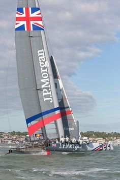 Sir Ben Ainslie's America's Cup wingsail catamaran 'J.P.Morgan BAR' approaching the finish line at Cowes during the J.P. Morgan Asset Management Round the Island Race. Ainslie set a new race record of 02:52:15.: