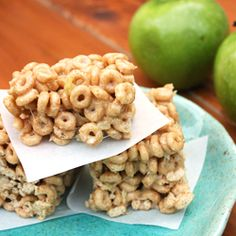 Apple Cinnamon Treats Recipe  1 apple, peeled & cored  1 (10 oz) bag of marshmallows  1/2 C butter  1/2 t cinnamon  8 C Apple Cinnamon Cheerios  Shred apple using large holes of cheese grater. Squeeze juice out of  apples. In lg saucepan over medium heat, combine first 4 ingredients. Stir until marshmallows have completely melted. Add cereal in batches until incorporated. Spray 9x9 pan w/cooking spray. Spoon into greased pan & use wet hands to push into place. Let cool completely b4 cutting