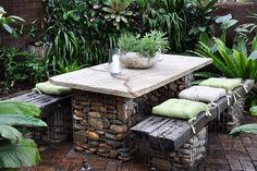 Gabion as a garden furniture---might be the safest way to support a huge rock slab.