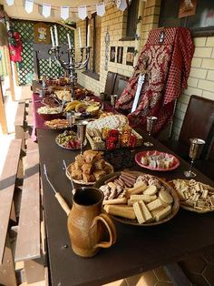 Medieval party food cheese heavy breads an meats utensils medieval banquet birthday party junglespirit Choice Image