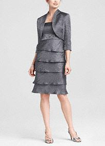 Short and chic, this hammered shimmer style is perfect for the modern mother or special guest.   Tank dress features empire waist embellished with jewel and sequin detail.  3/4 sleeve jacket offers extra coverage.  Tiered knee-length skirt is flattering and on trend.  Fully lined. Back zip. Imported polyester. Dry clean only.  Available in Platinum. Also available in plus sizes as Style 356480.  To protect your dress, our Non Woven Garment Bag is a must have!