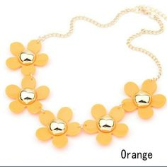 Summers Bright Colors  Flower Necklace. Nice bright orange flower petals with a gold metal center. These are so great with the bright and neon clothes line that is out for Summer and is staying in style through the winter. Adjustable chain for a perfect fit. Jewelry Necklaces