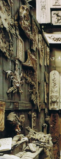 "All pieces and fragments I use to work.....Plaster casts copies of magnificent antique boiserie-carved paneling"". Feau & Cie Boiserie - image House and Garden"
