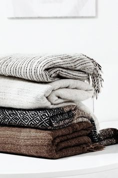 Try adding throws with natural texture to your home for the holidays