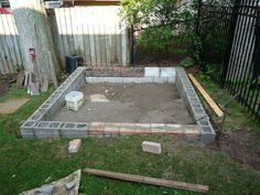 """Block foundation for Coop Greenhouse- buried to ground level (leveled with gravel sand). To keep animals from getting in/out to keep the boards from """"rotting."""" Put ridged insulation under the floor."""