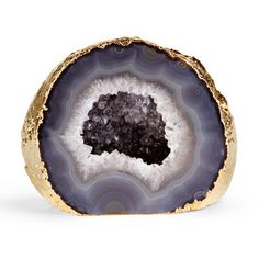 POPSUGAR Home Shops: Aerin: The dressing room in Aerins Manhattan apartment features shiny gold accents against soft, neutral shades. Source: Elle Decor : Add unique, earthy elegance to a side table or bookshelf with this gold-rimmed gray agate geode ($150).