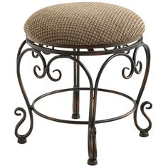 Designed as a companion to our Aledo Vanity, this swivel stool showcases the same elaborate wrought ironwork and antiqued bronze-colored finish. Art Nouveau-inspired with plush padded seat is upholstered with a scored pattern.